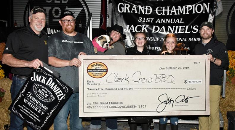 Clark-Crew-BBQ team holding award